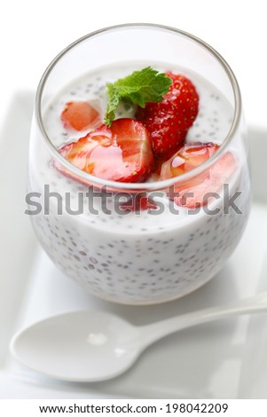 coconut chia seed pudding with strawberry - stock photo