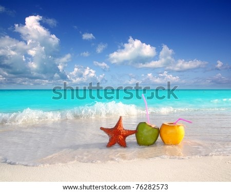 coconut cocktails juice and starfish in tropical aqua beach Caribbean [Photo Illustration] - stock photo