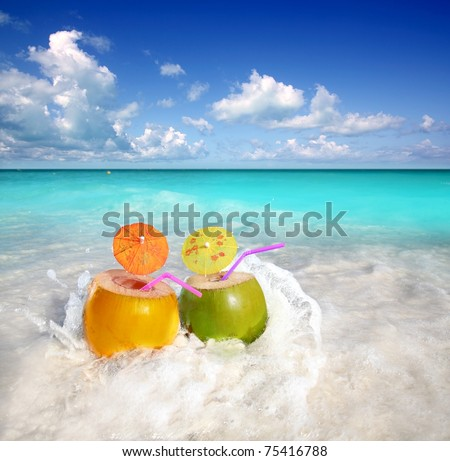 coconut cocktails juice in tropical beach water splash turquoise caribbean - stock photo