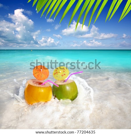 coconut cocktails juice in tropical beach water splash turquoise caribbean [Photo Illustration] - stock photo