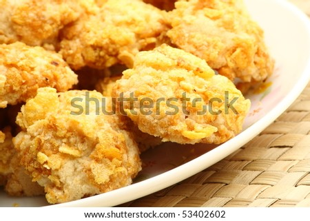 Coconut cookies coated with corn flakes
