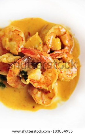 Coconut curry with shrimps and chili and coriander - stock photo