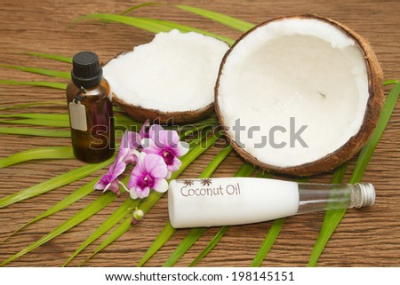 Coconut essential oil for alternative therapy and beauty spa - stock photo