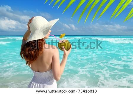 coconut fresh cocktail profile beach woman drinking tropical Caribbean [Photo Illustration] - stock photo