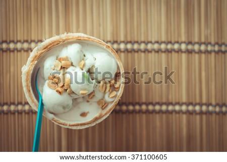 coconut Ice Cream with nuts ,  vintage tone - stock photo