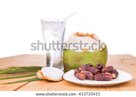 Coconut juice and sweet dates are simple and common iftar break fast food for muslim during fasting month of Ramadan - stock photo