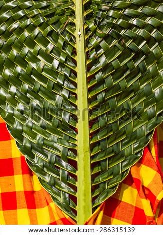 Coconut leaf weaving decoration for celebration. - stock photo