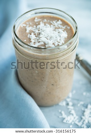 Coconut mocha smoothie for breakfast with fresh coconut - stock photo