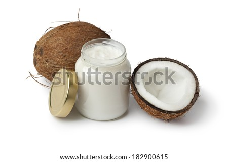 Coconut oil and fresh coconut on white background - stock photo