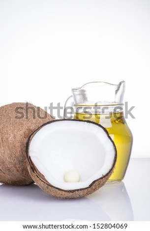 Coconut oil for alternative therapy on white background - stock photo