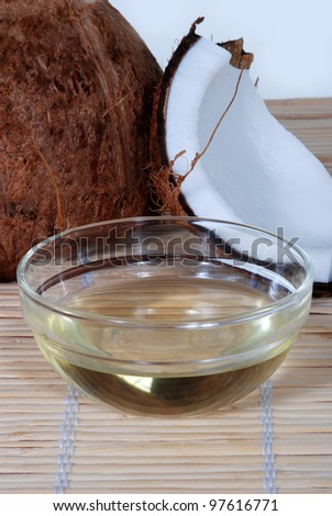 Coconut oil on a bamboo mat - stock photo