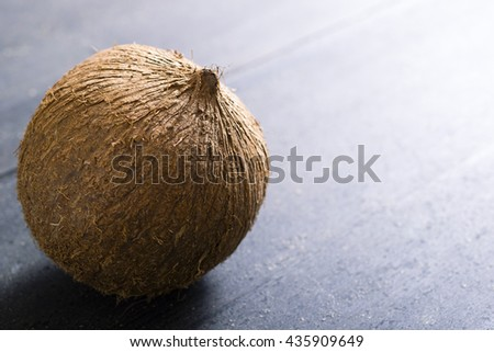 coconut on dark wooden table background