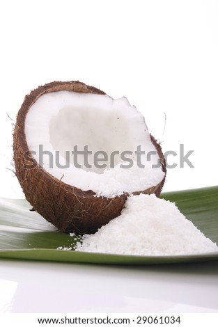 Coconut on green leaf - stock photo