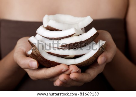 Coconut on hands. SPA collection. - stock photo