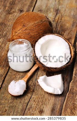 Coconut on the wooden table - stock photo