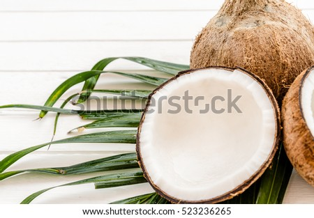 Coconut on white wooden background