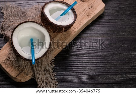 Coconut on wooden table. Organic healthy food concept.Beauty and SPA concept.