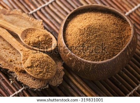 Coconut palm sugar in a bowl - stock photo