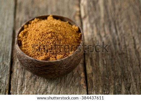 coconut palm sugar on wooden surface
