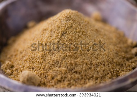 Coconut Palm Sugar (selective focus) on an old wooden table - stock photo