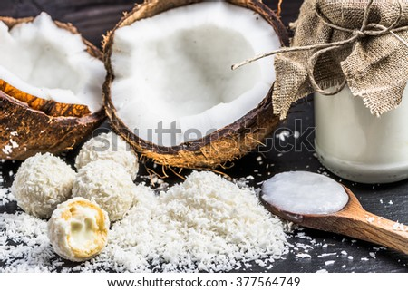 Coconut products: coconut oil and coconut candies  - stock photo