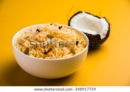 coconut rice, coconut sweet rice, sweet coconut rice also known as narali bhat in marathi, favourite Indian sweet, konkan food, kerala food, saffron, cashew, cloves, served in white bowl, isolated - stock photo