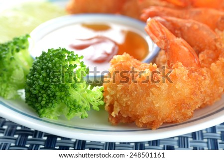 coconut shrimp with sauce and vegetable in plate  - stock photo