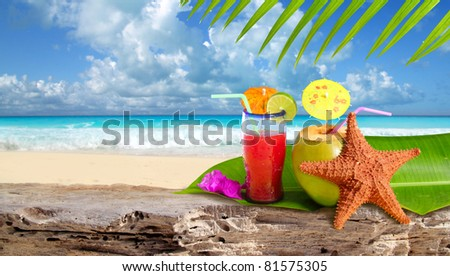 Coconut tropical cocktail with starfish over a Caribbean beach rock [Photo Illustration] - stock photo
