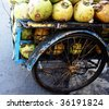 Coconut vendor, typical street business in Asia - stock photo