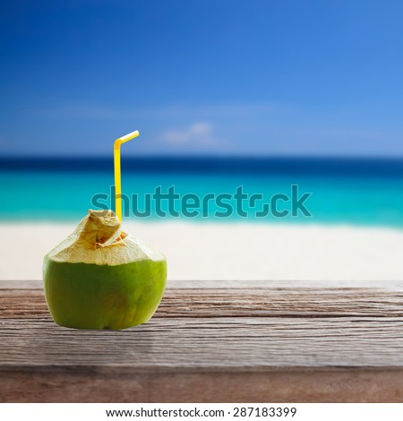 Coconut water drink on wooden table. - stock photo
