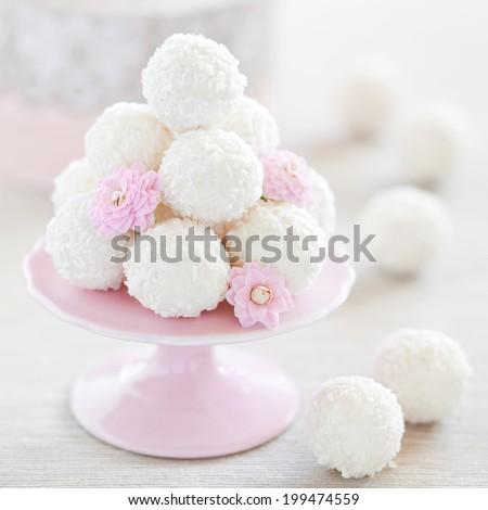 Coconut white chocolate truffles, selective focus - stock photo