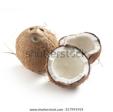 coconut whole and half on a white background with a soft shadow.