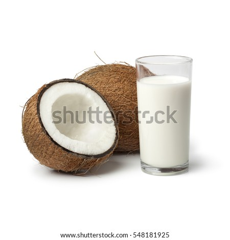 Coconut with a glass of coconut milk  on white background