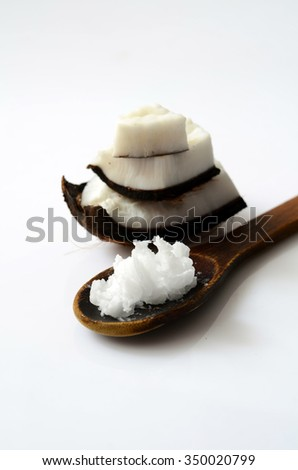 Coconut with coconut oil in a spoon - stock photo