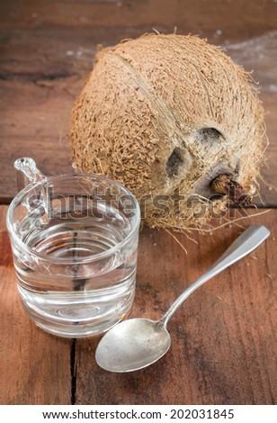 Coconut with coconuts distill oil.  - stock photo