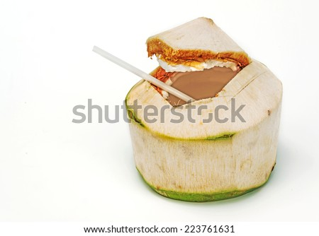 Coconut with drinking straw on white background.