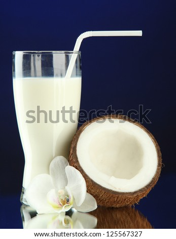 Coconut with glass of milk,  on blue background