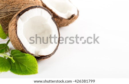 Coconut with leaves isolated on white background. - stock photo