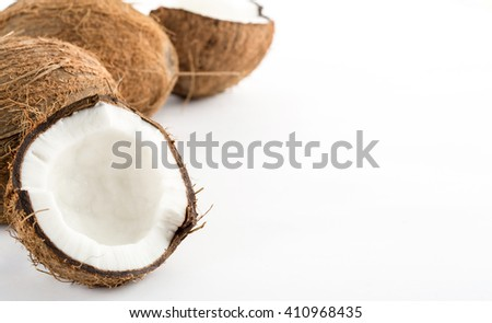 Coconut with leaves isolated on white background. Space for text on the right - stock photo