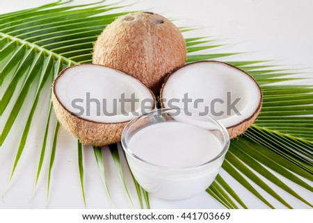 Coconut with milk  on coconut leaf background - stock photo
