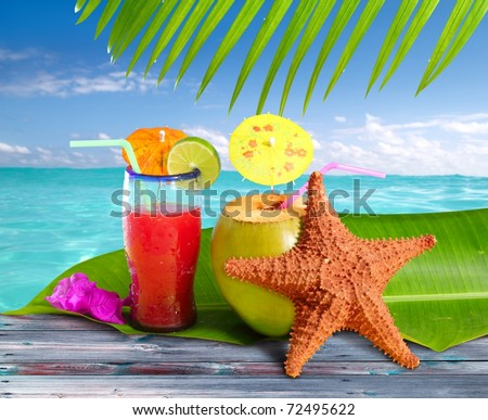 coconuts cocktails straw tropical caribbean beach with starfish [Photo Illustration] - stock photo