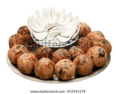 Coconuts on a tray, isolate. - stock photo