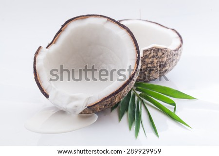 Coconuts with cream and leaf - stock photo