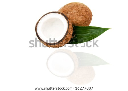 Coconuts with green leaf isolated on white - stock photo