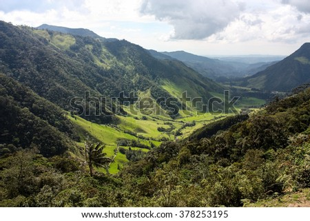 Cocora Valley, one of the most beautiful landscape of Colombia, which is nestled between the mountains of the Cordillera. Cocora Valley is the gateway to Parque Nacional Natural de los Nevados. - stock photo