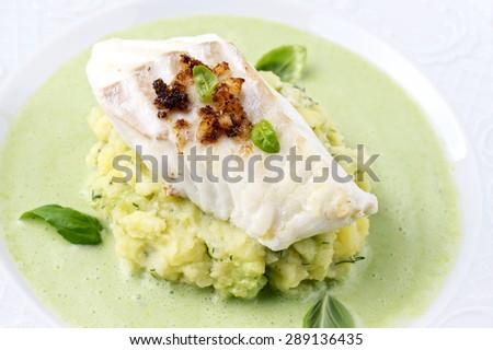 Cod fillet in Basil Champagne Foam - stock photo