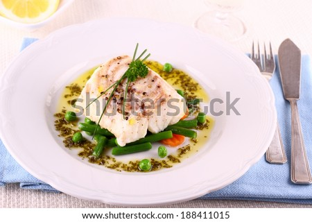 Cod Fillet with green beans, peas, parsley, olive oil and wine - stock photo