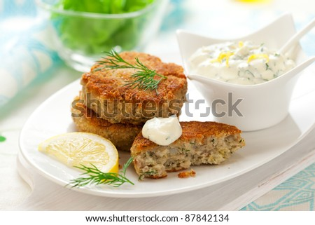 Cod Fish Cakes with sauce - stock photo