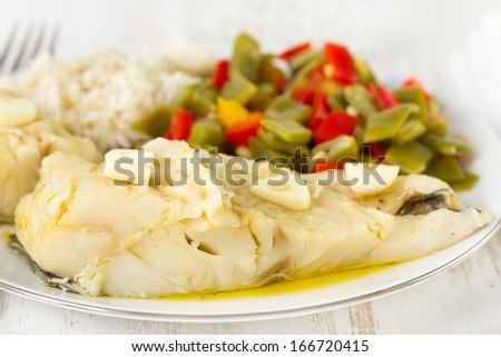 cod fish with vegetables and boiled rice - stock photo