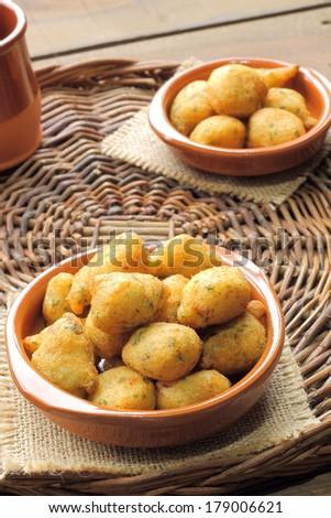 Cod fritters, traditional Spanish tapas Bunuelos de Bacalao - stock photo